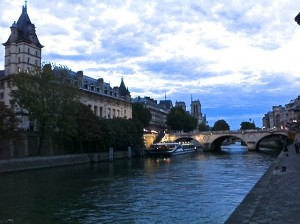 Picture of the Seine at dusk, with lots of blues and ruffled clouds