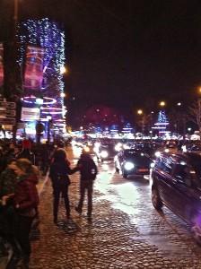 Paris streetscape, night, Christmas lights, crowds