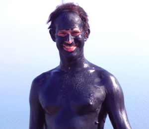 Man wearing Dead Sea mud